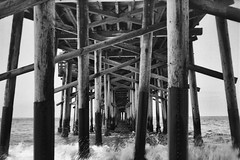 Under the Pier (Michael VH) Tags: pier ocean wave water wood structure yashica a delta 100 11 12 minutes 68f self developed black white film tlr