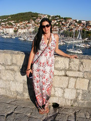 Nina - Stunning View at Kamerlengo Castle in Trogir Croatia (sean and nina) Tags: nina kamerlengo castle fort fortification trogir ciovo croatia hrvatska adriatic coast sea boats yacht woman female girl lady pose posed posing long white summer dress august 2016 sandals beauty beautiful gorgeous stunning charm charming sun sunglasses tan tanned skin feet toes handbag mobile phone dark hair brunette smile smiling happy wife married fiancee girlfriend shoulders arms hands face pink lips neck necklace throat tourist vacation holiday stone wall path standing people person public outdoor outside