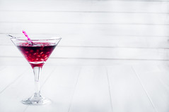 Pomegranate martini with  seeds in a glass (lyule4ik) Tags: