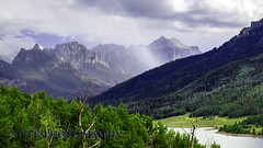Betwixt (VFR Photography) Tags: ridgway ouraycounty colorado co silverjackresevoir lake lakes nature landscape uncompahgrenationalforest usfs cimmaronrange sanjuanmountains rockymountains sunbeam sunbeams sky skies cloud clouds rugged crags craggy distance forest forests tree trees alpine