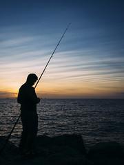 Paper evening skies (Albion Harrison-Naish) Tags: silhouette australia olympus perth wa cottesloe westernaustralia cottesloebeach em5 streetphotogoraphy olympusem5 lumixg20f17ii albionharrisonnaish