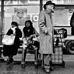 DSCN3628 (Akbar Simonse) Tags: city people urban man holland netherlands hat bench square glasses nikon women trolley candid nederland streetphotography bank denhaag moustache haag raincoat centrum thehague bril tramstop snor hoed melodia vierkant tramhalte lahaye sgravenhage agga straatfotografie regenjas akbarsimonse