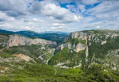 At the gates of Verdon (lifehappenstoyou) Tags: light sky france mountains green clouds landscape rocks europe cotedazur canyon cliffs valley provence verdon alpesdehauteprovence gr4 gorgesduverdon grandcanyonduverdon rougon d700