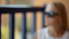 Woman on a cafe terrace (greycoastmedia) Tags: summer portrait people woman motion girl look sunglasses closeup female person video cafe drink terrace juice balcony watch young fast sunny observe slider dolly tracking refreshment footage refresh stockvideo greycoastmedia