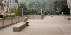 melbourne-1144-ps-w (pw-pix) Tags: city people urban green glass modern concrete grey beige alone sitting steel space australia federationsquare melbourne victoria area cbd fenced isolated glazed paved fedsquare