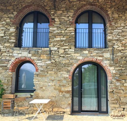 Serramenti DUO Legno-Alluminio con vetro strutturale.