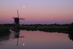 Moon over mill (alideniese) Tags: kinderdijk southholland thenetherlands windmill molen reflection moon sky pink purple evening dusk sundown water canal field landscape waterscape outdoors