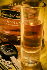Handle with care. (rosserx) Tags: macromondays shotglass brandy alcohol liquer booze car keys driving drinking amber lighting handlewithcare