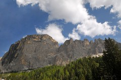 Travelling Sella Pass (Vee living life to the full) Tags: italy leger travel touring holiday landscape rock pass pordoi sella towers sasspordoi mountain people nikond300 heathaze valley floor motorcycle view car park road sky cloud blue