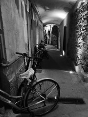 Parked (cyclingshepherd) Tags: 2016 october italy cinque terre monterosso monochrome bw alley bike bikes rad fahrrad frejus light cyclingshepherd panasonic tz70 mare liguria blackandwhite bicicleta shade darkness shadows alleyway street mudguard plasticbag carrierbag arch arches archway archways lights chain lock padlock pipe pipes drain stone stonework velo vlo streetlights sandwichboard afterdark