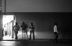 Framed. (Presence Inc) Tags: street light people urban bw stilllife rain silhouette night reflections photography singapore streetphotography panasonic nightlife littleindia shape urbanscape nightpeople gx7