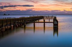 Dawn from Space View Park (Ed Rosack) Tags: longexposure sky usa cloud reflection bird water animal architecture sunrise buildings river landscape dawn dock lowlight unitedstates florida cloudy lagoon explore titusville centralflorida othermanmade edrosack