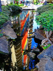 Water Art: Watery Rainbow Tower (peggyhr) Tags: sky sunshine reflections hawaii pond rocks shadows vegetation rainbowtower peggyhr dsc06084a