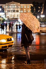 (Georgina ) Tags: road people reflection wet rain umbrella walking nightshot athens greece puddles carheadlights