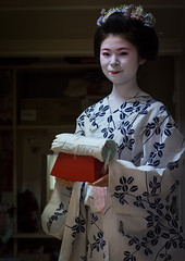 16 Years old maiko called chikasaya with the pillow shes uses to protect her hairstyle, Kansai region, Kyoto, Japan (Eric Lafforgue) Tags: wood red woman white beautiful beauty face japan vertical female hair asian japanese clothing eyes kyoto colorful asia pretty feminine candid painted young culture makeup grace pillow indoors teen maiko geisha teenager kimono gion tradition oriental youngadult solitary hairstyle youngwoman apprentice oneperson hairbun elaborate kanzashi lookingatcamera 1617years oneyoungwomanonly 1people kansairegion japaneseethnicity colourpicture japan161923 chikasaya komayaokiya