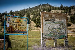 Not so Welcoming Sign (lone_krusader) Tags: old flowers pakistan summer plants green beautiful landscape nikon outdoor map board enjoy welcome dslr damaged juniper lightroom memorable flowersplants balochistan ziarat d5200