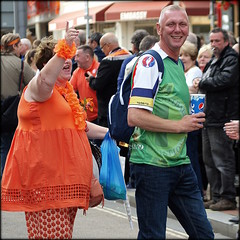 Getting his marching orders (* RICHARD M (Over 6 million views)) Tags: street candid orangemensday orangeorder orangelodge loyalorangelodge lol smiles fun crowds orangedress thetwelfth 12thjuly southport sefton merseyside parades domestic troublestrife onyerbike marchingorders thedecisivemoment