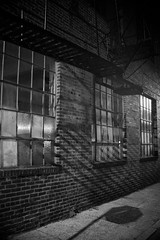 (John Donges) Tags: philadelphia city streets night dark shadows blackandwhite brick building industrial windows fireescape sidewalk 0812