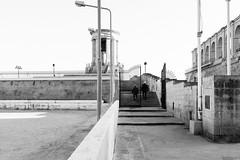 Entrance to the memorial (lorenzoviolone) Tags: agfascala200 bw blackwhite blackandwhite finepix fujix100s fujifilm fujifilmx100s lamps monochrome monument passage stairs vsco vscofilm x100s lavalletta malta mirrorless strangers streetlamp streetphoto streetphotobw streetphotography trip:malta=feb2016 warmemorial valletta