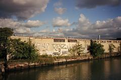(Levi Mandel (@levimandel)) Tags: 35mm film scan color magic street newyorkcity queens waterway river revs cost graffiti clouds