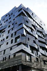 Shiny black building facade, unusual angles (Monceau) Tags: black shiny faade building apartments avenuedefrance paris 13tharr irregular balconies windows
