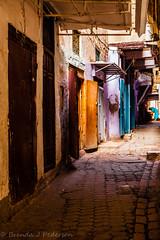 Each day is a little life (Culinary Fool) Tags: africa november woman color aqua doors turquoise bricks unescoworldheritagesite cobblestones morocco medina walls souks fes 2012 culinaryfool 2470mm28 suqs fesalbali brendajpederson