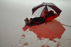 Enjoy the white beaches of Oklahoma (radargeek) Tags: snow oklahoma umbrella mustang ok sled