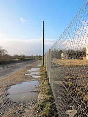 Puddles (Explored) (JulieK (should be doing housework)) Tags: road ireland irish clouds fence puddle cork bluesky pole hff n72 inexplore canong11 fencefriday 2015onephotoeachday