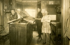 Composing Room in a Print Shop (Alan Mays) Tags: ephemera postcards realphotopostcards rppc photos photographs foundphotos portraits printshops printers composingrooms rooms interiors typecases type cases uppercases uppercase upper lowercases lowercase lower letters lettercases men clothes clothing aprons stripes suspenders moustaches foldedarms crossedarms crossed folded arms occupational occupations antique old vintage