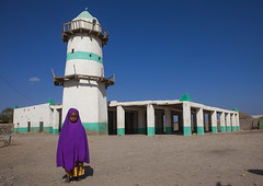 Afar Tribe Little Girl In Front Of Mosque, Assaita, Ethiopia (Eric Lafforgue) Tags: africa travel blue girls sky people girl childhood horizontal architecture scarf outdoors photography wo