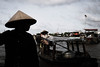 Vendors on the Mekong (OpersembeArt) Tags: trip blue red green hat contrast canon river dark eos sticks vietnamese village bright market cone floating delta vietnam pineapple vendor selling hue mekong bacpacking insense 700d canon700d canoneos700d eos700d