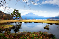 Kawaguchiko lake (Patrick Foto ;)) Tags: morning travel autumn trees light red wallpaper sky mountain lake reflection fall nature water beautiful leaves yellow japan season landscape outdoors japanese volcano evening maple pond scenery asia day fuji mt view place natural famous seasonal scenic landmark scene foliage mount jp destination sakura fujisan mtfuji kawaguchi kawaguchiko yamanashiken minamitsurugun