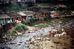 33-30 (ndpa / s. lundeen, archivist) Tags: nick dewolf nickdewolf color photographbynickdewolf 1970s 1972 fall film 35mm winter republicofchina taiwan taiwanese china chinese rural rurallife buildings houses homes river water clothes clothesline clotheslines 1973 yilancounty easterntaiwan yilan ilan eastcoast 33 reel33