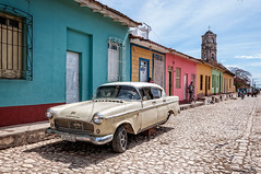 On the road to nowhere... (danielacon15) Tags: cuba trinidad 2016 streetphotography cobblestone car wreck colorful houses church cart background street countryside outdoors travel