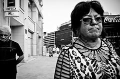 _DSC2744 (stimpsonjake) Tags: nikoncoolpixa 185mm streetphotography bucharest romania city candid blackandwhite bw monochrome oldwoman eyecontact face dress sunglasses