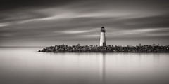 Seven 4 Five (maxxsmart) Tags: california longexposure winter blackandwhite bw santacruz seascape monochrome sunrise landscape rocks pacific pacificocean tetrapod walton breaker 2015 twinlakesbeach waltonlighthouse d810 nikond810 zeiss50mm14 leebigstopper maxxsmart