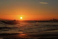 Surfs Up Suns Down (FeistyTortilla) Tags: ocean sunset sky orange beach surf waves surfer surfing newportbeach backlit huntingtonbeach subline