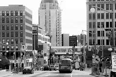 Metropolis. (Wilickers) Tags: canon 60d black white monochrome architecture street bus buildings busy vehicles posts signs canada ottawa ontario