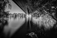 high tide (Zesk MF) Tags: bridge bw white black water dark flow nikon under dramatic floating sigma brcke 8mm trier longtime langzeit greyfilter zesk nd1000 graufilter