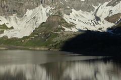 le soleil arrive.. (bulbocode909) Tags: valais suisse salenfe montagnes nature lacs neige reflets eau