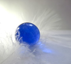 Macro Monday- Opposites - Hard /Soft, Smooth/Fluffy (Kaos2) Tags: macro macromonday opposites marble blue feather soft hard fluffy smooth glass