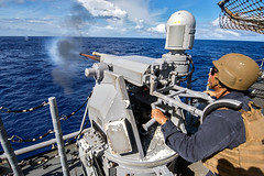 Sailors on USS Chancellorsville fire Mk-38mm machine gun during live fire exercise (#PACOM) Tags: hurricanematthew storm gtmo meteorology weather shelter evacuation navy usnavy uspacificcommand pacom