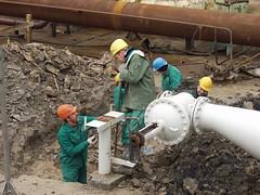 Color helmets (algimantas_tirlikas) Tags: building chimney construction crane montage mounter pipeline pipes rafinery workman work outdoor