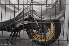 The Golden Wheel (larry_shone) Tags: motorbike wheel gold selectivecolour urban abstract
