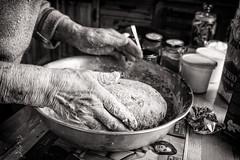 Ag Déanamh Aráin / Making Bread 11 (soilse) Tags: 2009 anghaeltacht cnocastolaire deireadhfómhair donegal dúnnangall gaeltacht gweedore ireland mum october october2009 tateandlyle tírchonaill agbacáil agdéanamharáin arm arán baking bakingtin blackandwhite bread breadmaking ceird cisteanach cistin concentration craft daylight daylightportrait flour glassjars greased greasedbakingtin greasedtin hands ingredients jars kitchen makingbread monochrome naturallight portrait portraiture portráid raising sultanas table tins treacle tábla éirinn