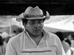 butcher seller (guilletho) Tags: blackandwhite blancoynegro bw monochrome blackwhite mexico noiretblanc hat portrait streetphoto seller monocromatico canon