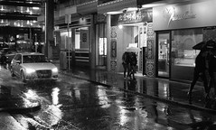 Chinatown in the Rain (Leon Sammartino) Tags: street sunset white black rain chinatown saturday melbourne audi umbrellas puddles x10 photogrpahy fujufilm