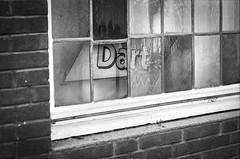 Da (chipsmitmayo) Tags: blackandwhite film window sign sport analog nikon f14 fenster 85mm f100 150 schild 100 nikkor agfa rodinal schwarzweiss apx dart mnster kneipe selfdeveloped adonal selbstentwickelt