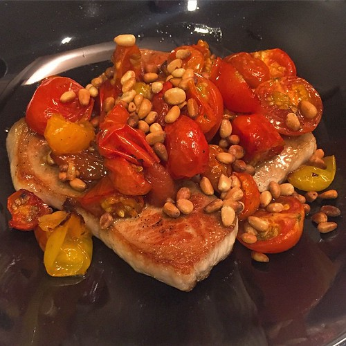 home-cooked sous vide pork chop, roasted cherry tomatoes and pine nuts.
