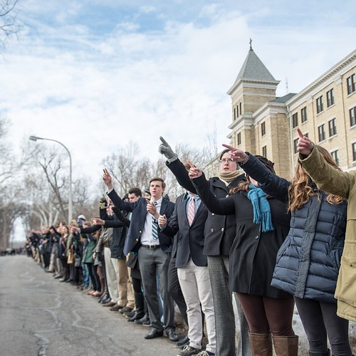 Students sing the alma mater prior to Fr. Ted's burial procession to Holy Cross Cemetery.